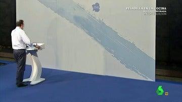 El mitin de Mariano Rajoy de cara a la pared