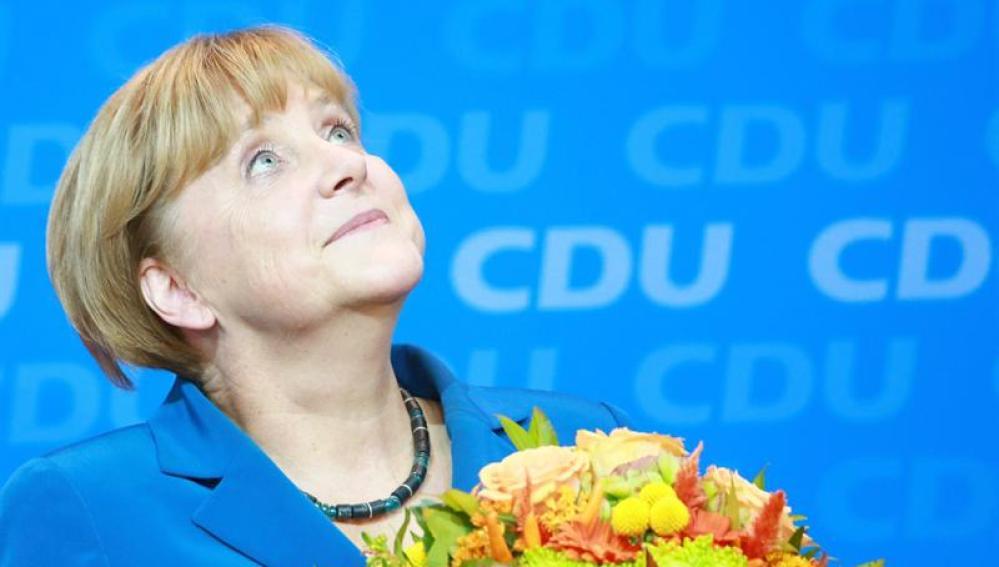 Angela Merkel sobre un fondo de la CDU