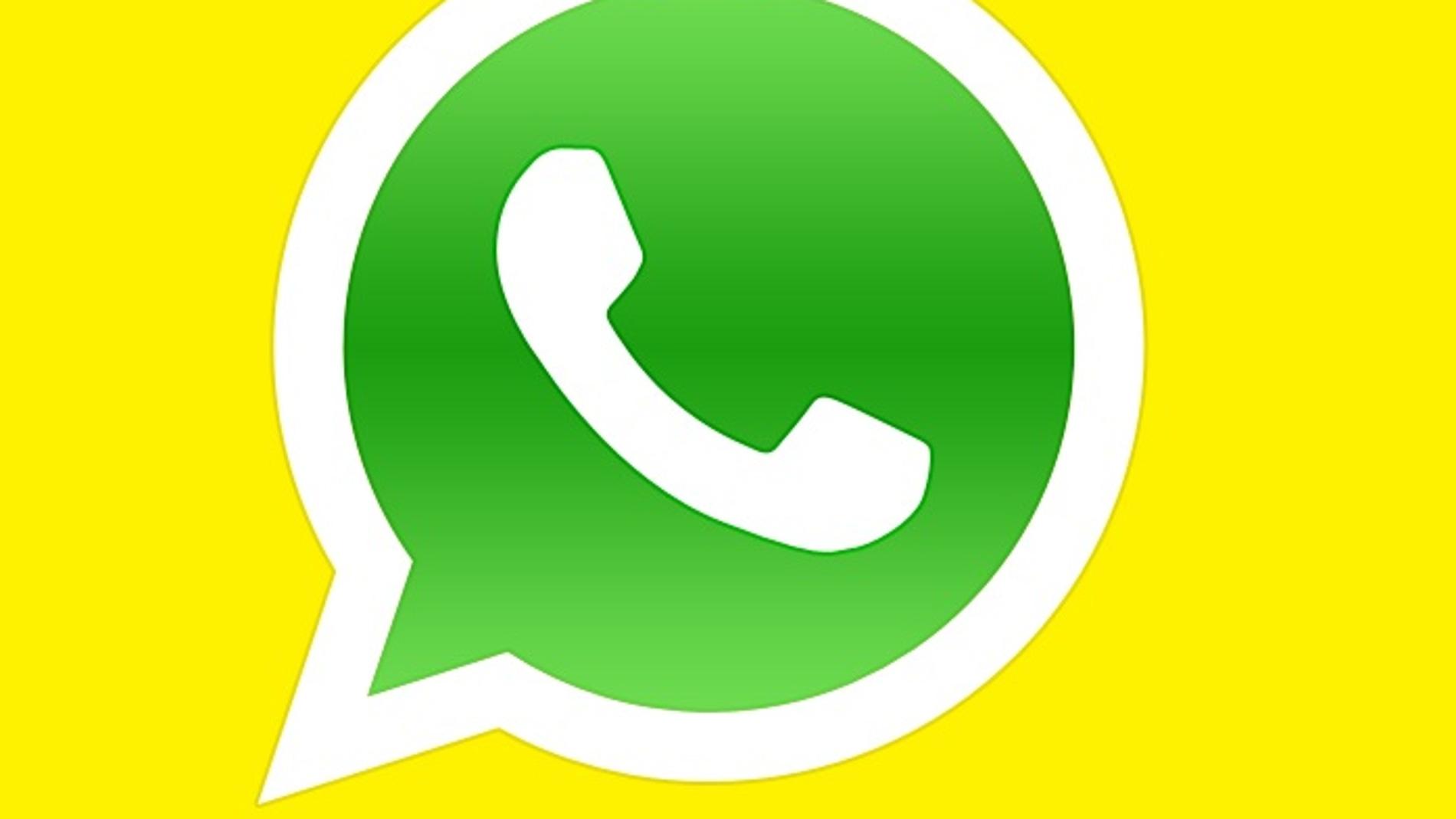 Icono de WhatsApp sobre un fondo amarillo