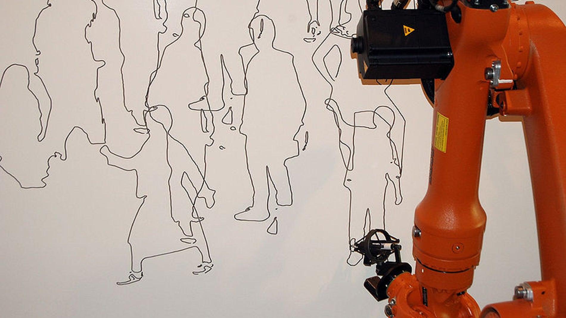 Robot industrial que pinta cuadros