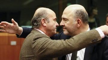 El comisario de Asuntos Económicos y Financieros, Pierre Moscovici y Guindos