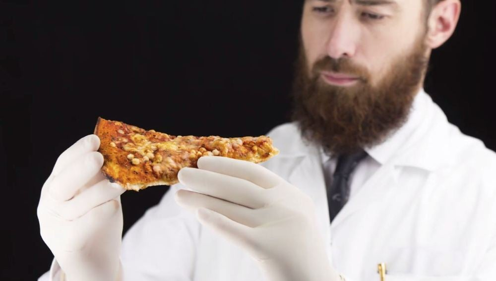 Hay una explicación científica para que no puedas dejar la pizza