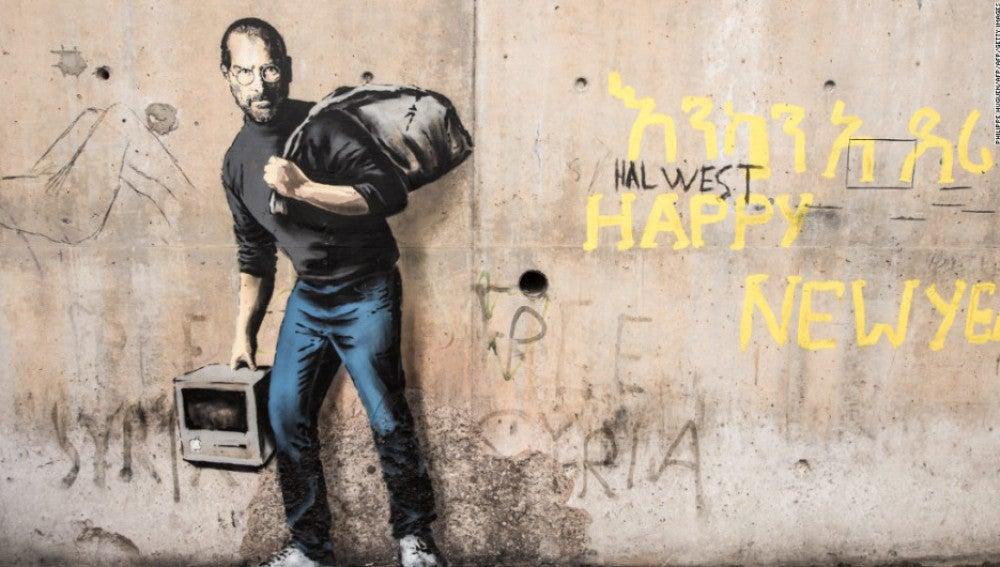 Grafiti de Banksy en el centro de refugiados 'La Jungla' de Calais