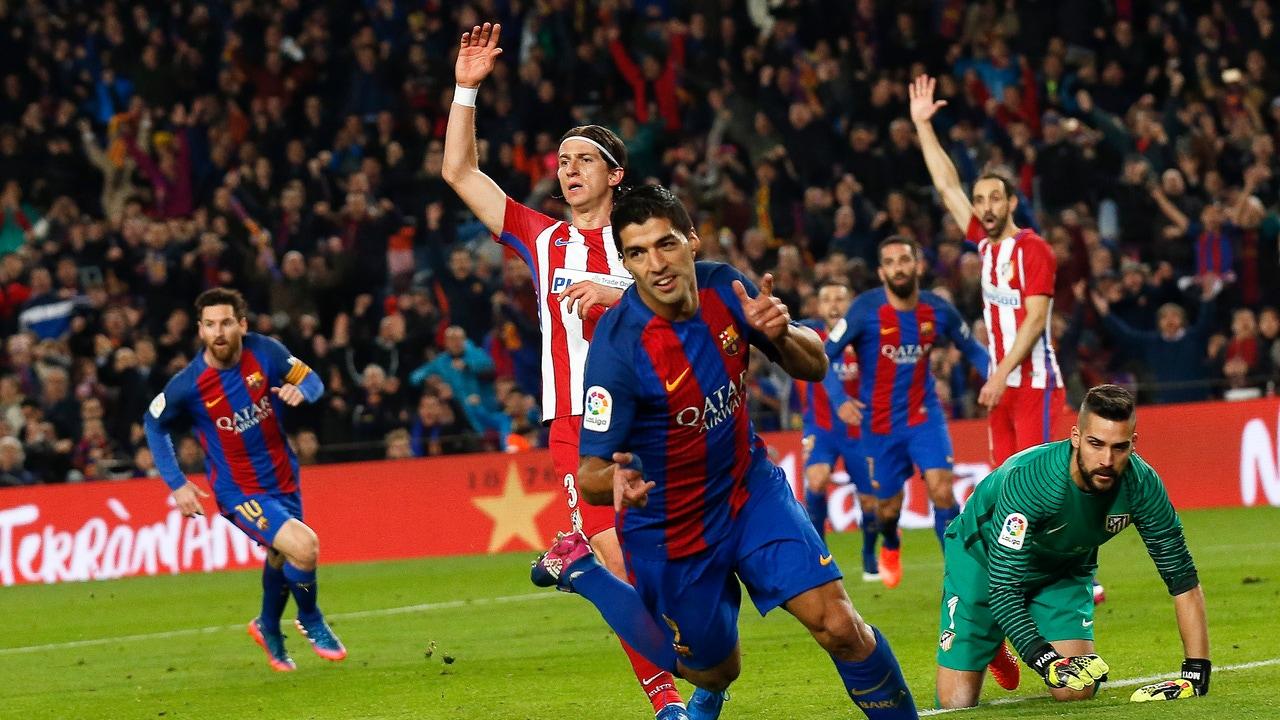 Luis Suárez celebra su gol contra el Atlético de Madrid