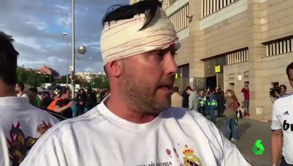 Frame 54.578571 de: Once aficionados resultan heridos tras cargas policiales en el Vicente Calderón
