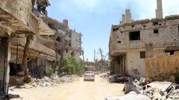 Vista de los daños registrados en algunos edificios, en la ciudad de Al Zabadani, recuperada por el ejército sirio al oeste de Damasco (Siria)