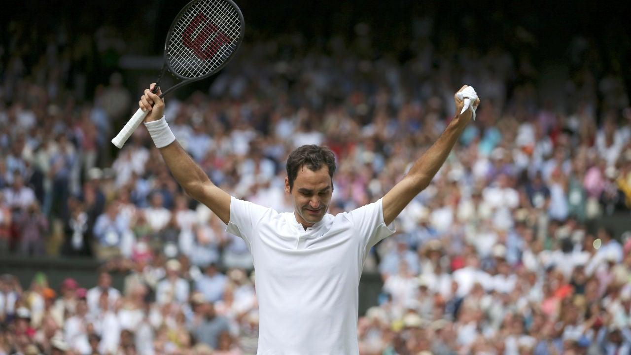 Roger Federer celebra su victoria en Wimbledon
