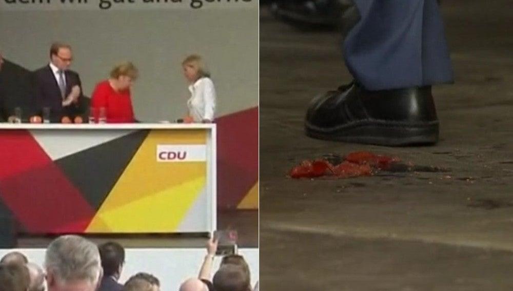 Lanzan varios tomates a Angela Merkel