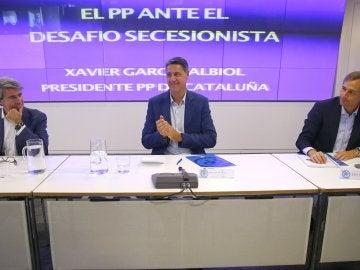 El presidente del PP de Cataluña, Xavier García Albiol (c), durante su participación en el Aula de Formación Continua del PP de la Comunidad de Madrid