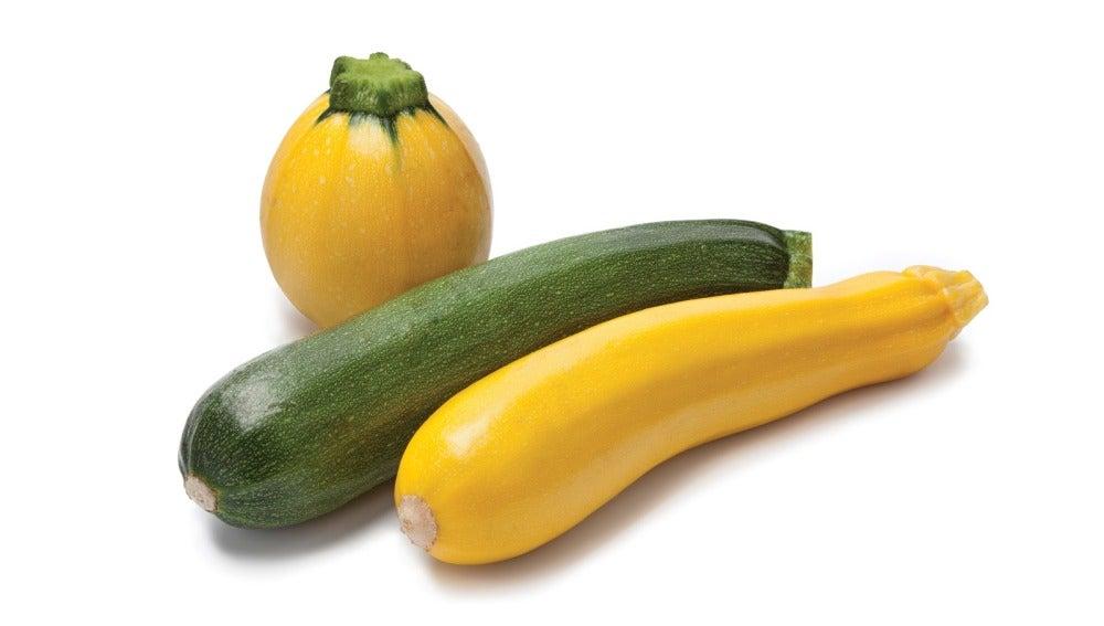 Un calabacín amarillo y otro verde