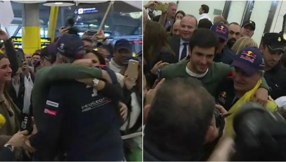 Carlos Sainz se abraza a su hijo en la llegada a Barajas