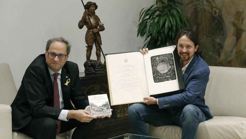 El presidente catalán, Quim Torra, y el secretario general de Podemos, Pablo Iglesias