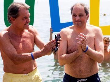 El presidente de la Generalitat Quim Torra, participa junto al expresidente Artur Mas