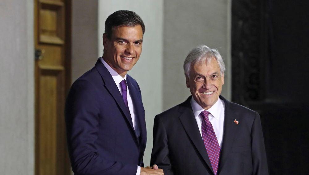 Pedro Sánchez y Sebastián Piñera