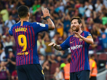 Messi y Suárez celebran un gol