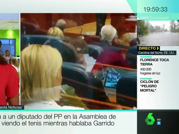 Graban a un diputado del PP en la Asamblea de Madrid viendo el tenis mientras hablaba Garrido