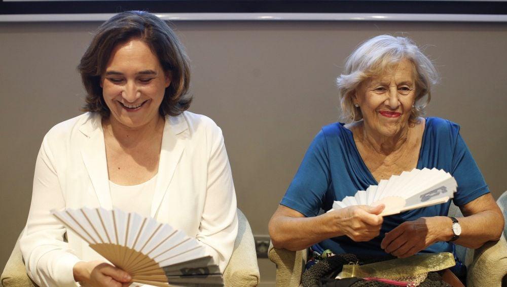 Colau y Carmena, durante el foro en el que han participado en Barcelona