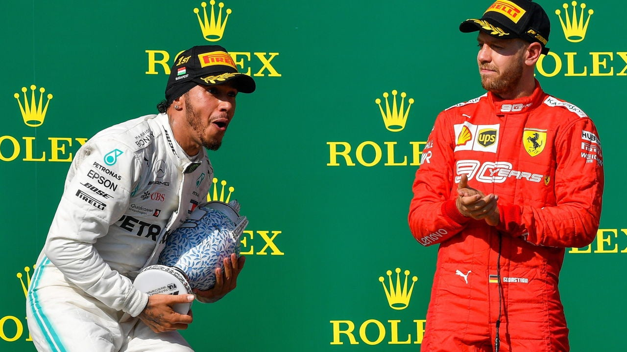 Lewis Hamilton en el podio junto a Sebastian Vettel en el GP de Hungría