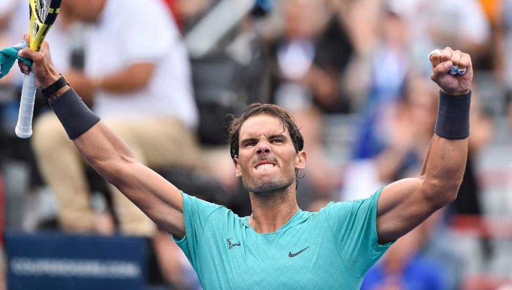 Rafa Nadal celebra su victoria contra Evans