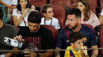 Luis Suárez y Leo Messi, en la grada del Camp Nou