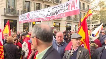 Cs abandona la marcha de Barcelona por la presencia de una pancarta contra la Ley de Violencia de Género