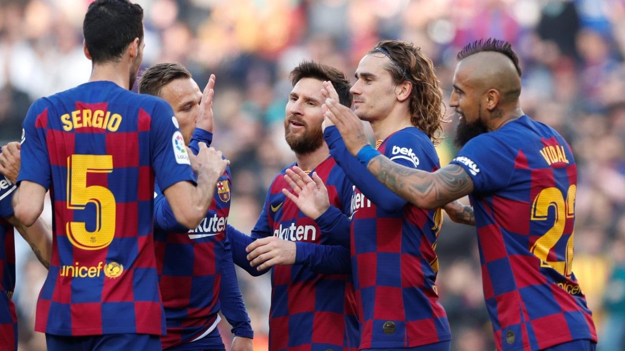 Los jugadores del Barça celebran un gol de Messi