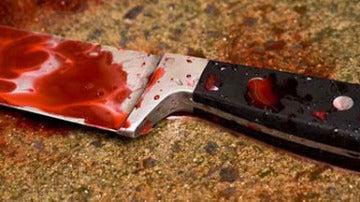 Imagen de archivo de un cuchillo ensangrentado