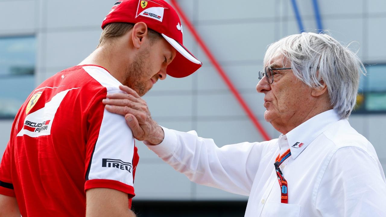 Ecclestone charla con Vettel