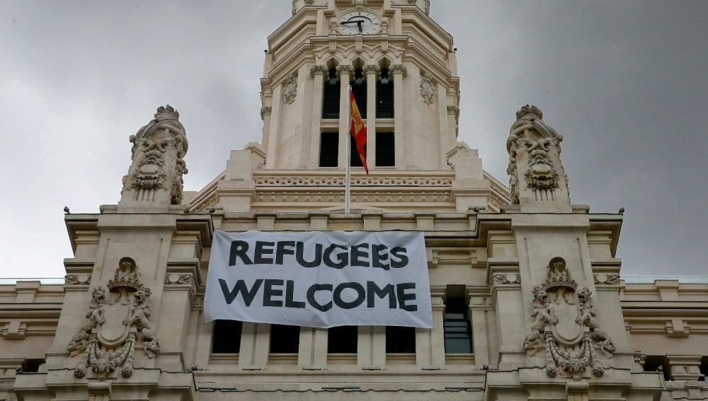 Pancarta refugiados en Madrid