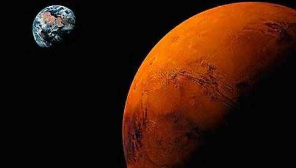 Recreación de Marte con la Tierra al fondo