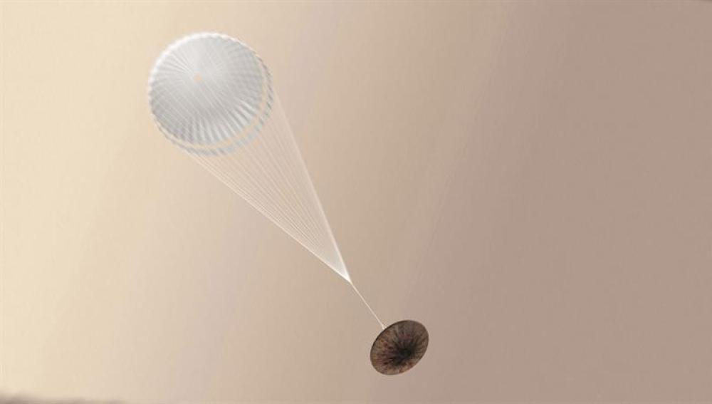 Imagen facilitada por la Agencia Espacial Europea (ESA) muestra una ilustración de un artista del módulo Schiaparelli durante su aterrizaje en Marte