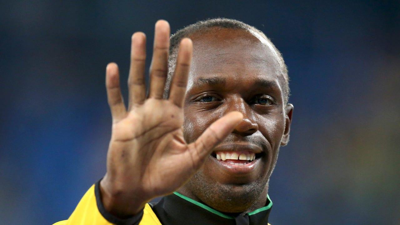 Usain Bolt saludando