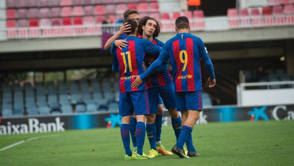 Jugadores del Barça B celebran un gol