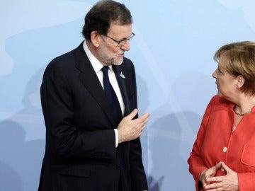 Mariano Rajoy y Angela Merkel en la cumbre del G-20