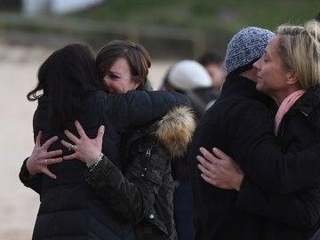 Familiares lloran la muerte de la mujer
