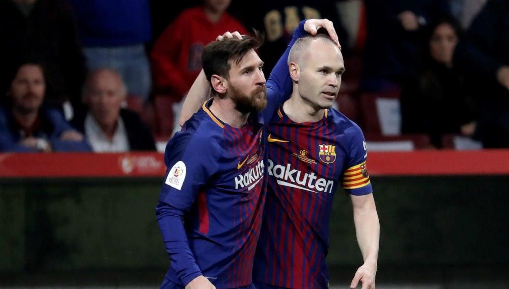 Messi, con Iniesta