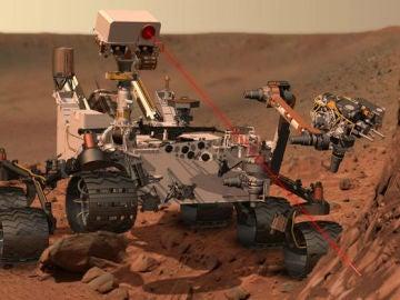 Representación artística del rover Curiosity disparando su rayo láser contra uno de los objetivos