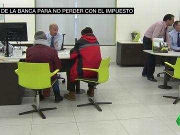 La banca ya paga el impuesto de las hipotecas, pero alerta: así puede repercutirte con nuevas comisiones y condiciones
