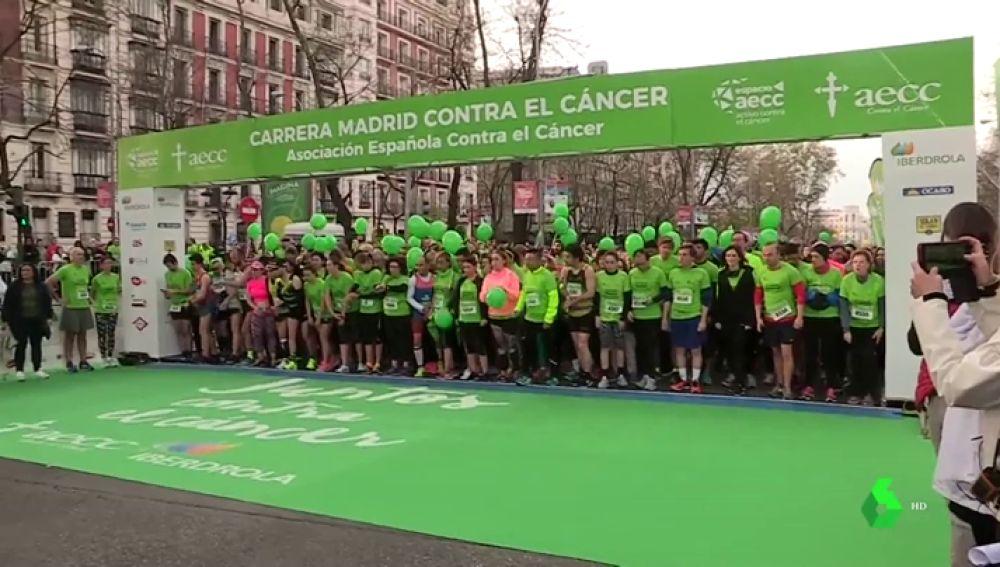 Participantes en la carrera contra el cáncer en Madrid