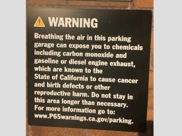 Cartel que alerta de padecer cáncer