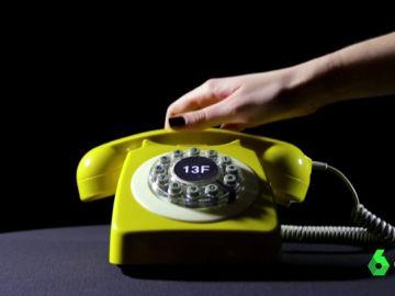 Imagen del teléfono amarillo de la conciliación.