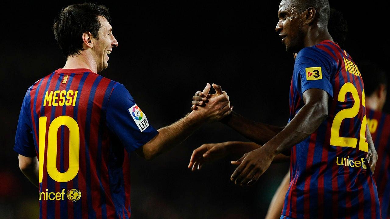 Messi en un partido con Abidal