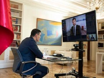 Pedro Sánchez y Pablo Casado, en su reunión telemática