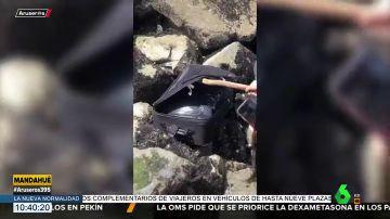 Descubren un cuerpo descuartizado dentro de una maleta cuando grababan un vídeo de TikTok en la playa