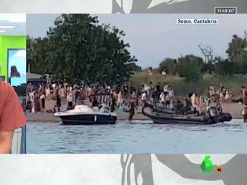 La Guardia Civil desaloja en lancha un botellón con más de un centenar de personas en Somo, Cantabria
