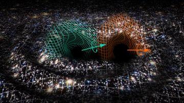 La fusion de dos agujeros negros en otro supermasivo desconcierta a la comunidad astrofisica