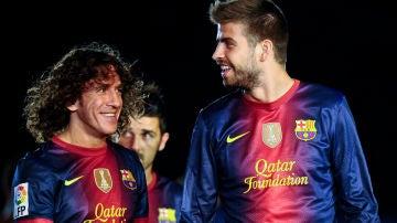 Puyol y Piqué, con el Barça